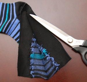 Cut straight down the sole of the socks