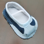 Sew the sole to the shoe upper