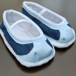 Hand sew the binding around the base of the shoe